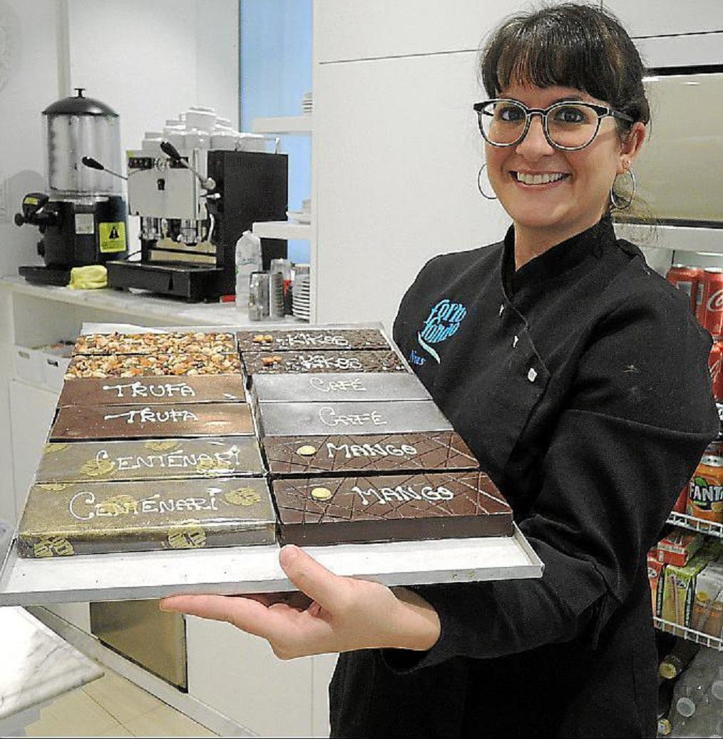 Neus Llull adds sweet Christmas specialities into the nougat which is handcrafted