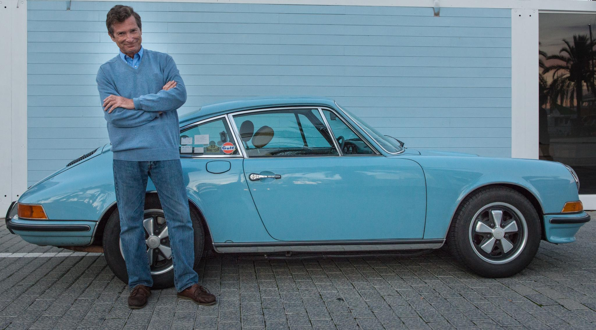 Early 911 wearing those fabulous Fuchs alloys with proud owner in matching outfit