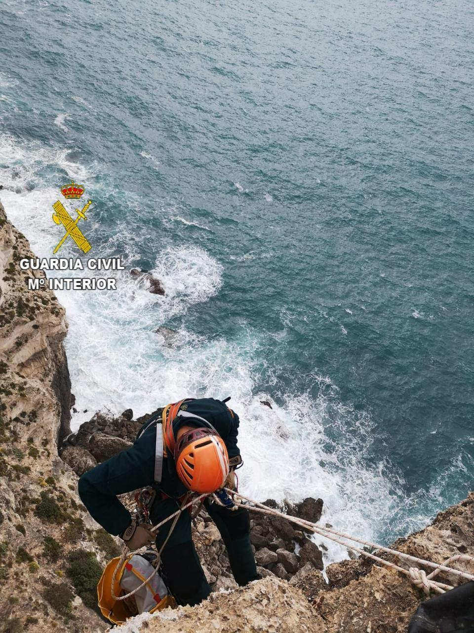 Guardia Civil Officers abseil down Cap Blanc cliffs.