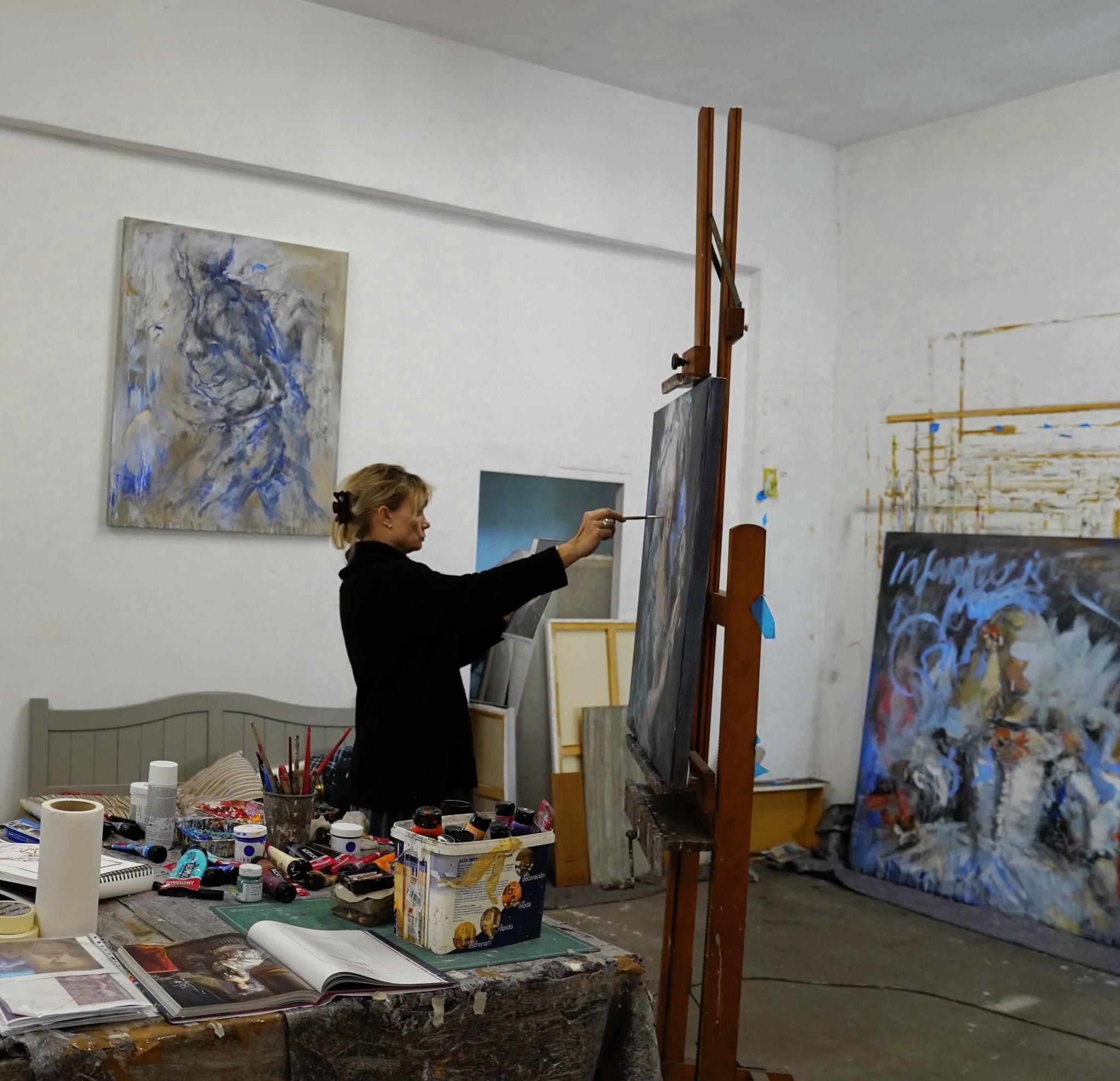 Mandy Racine painting in her studio