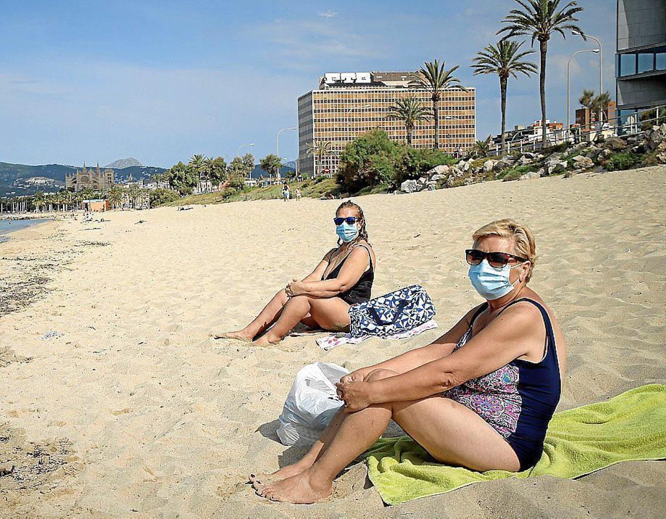Sunbathers wearing masks.