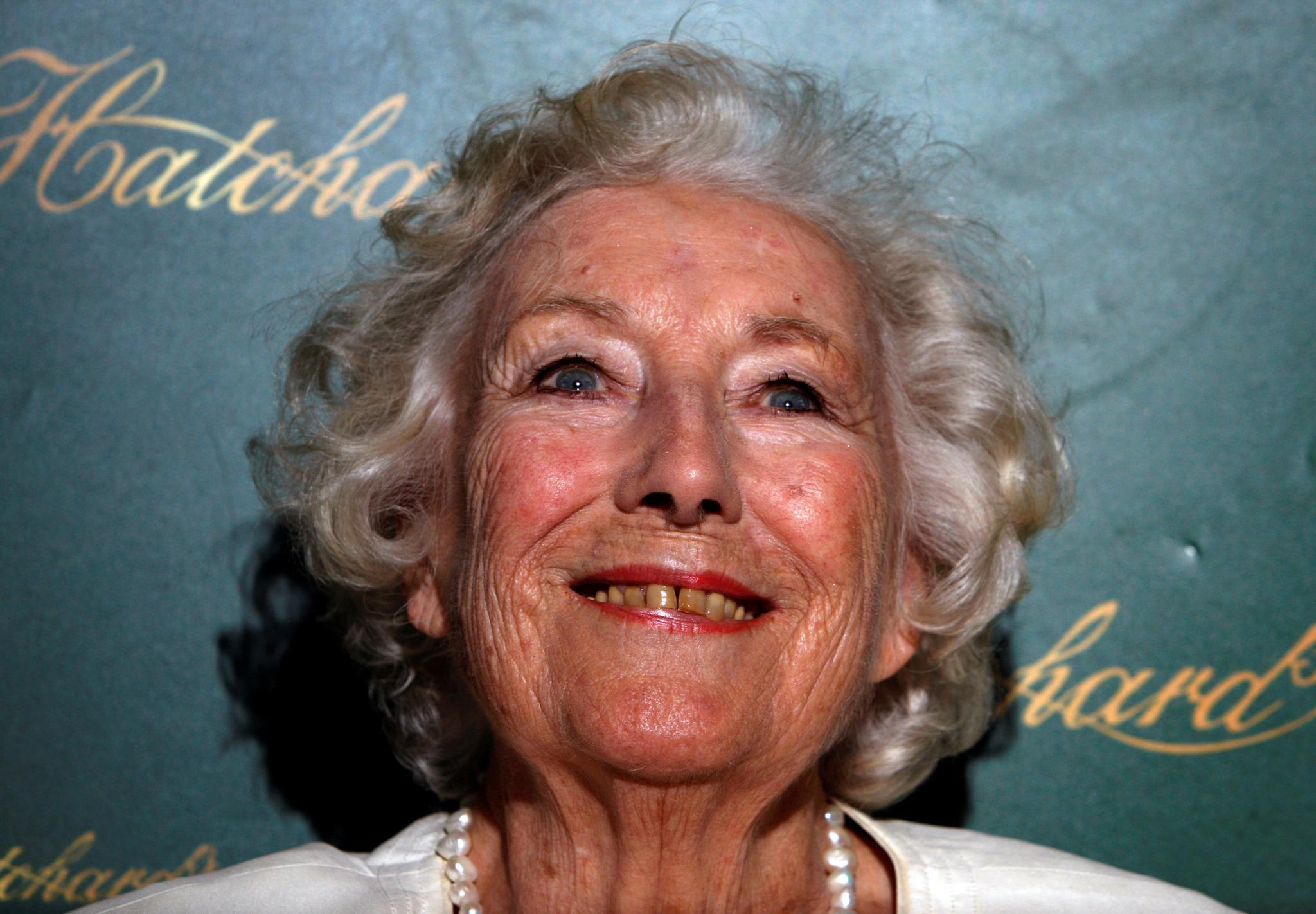 FILE PHOTO: Britain's World War Two singer Lynn smiles during a book signing of her autobiography in London