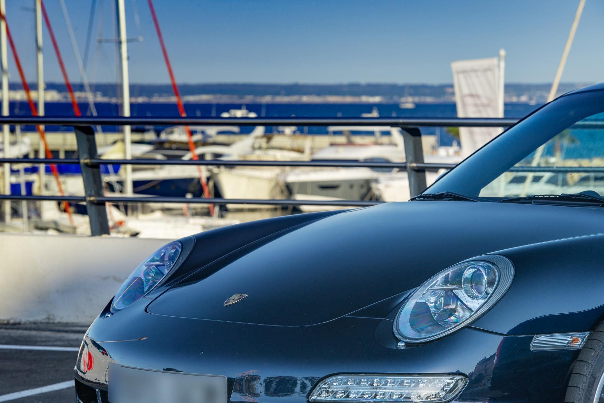Arty Porsche against Calanova harbour backdrop.