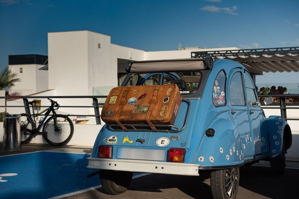 Citroen 2CV using flower power is packed and ready to go.