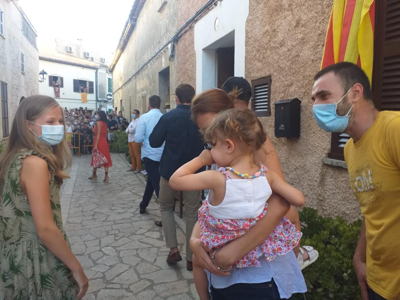 Princess Leonor hugs little girl in Petra.