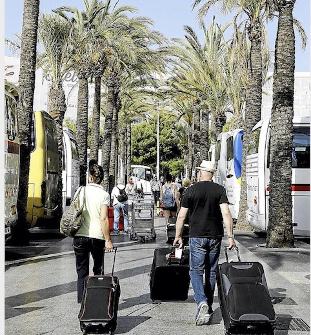 Tourists & Tourist Buses at Palma Airport.