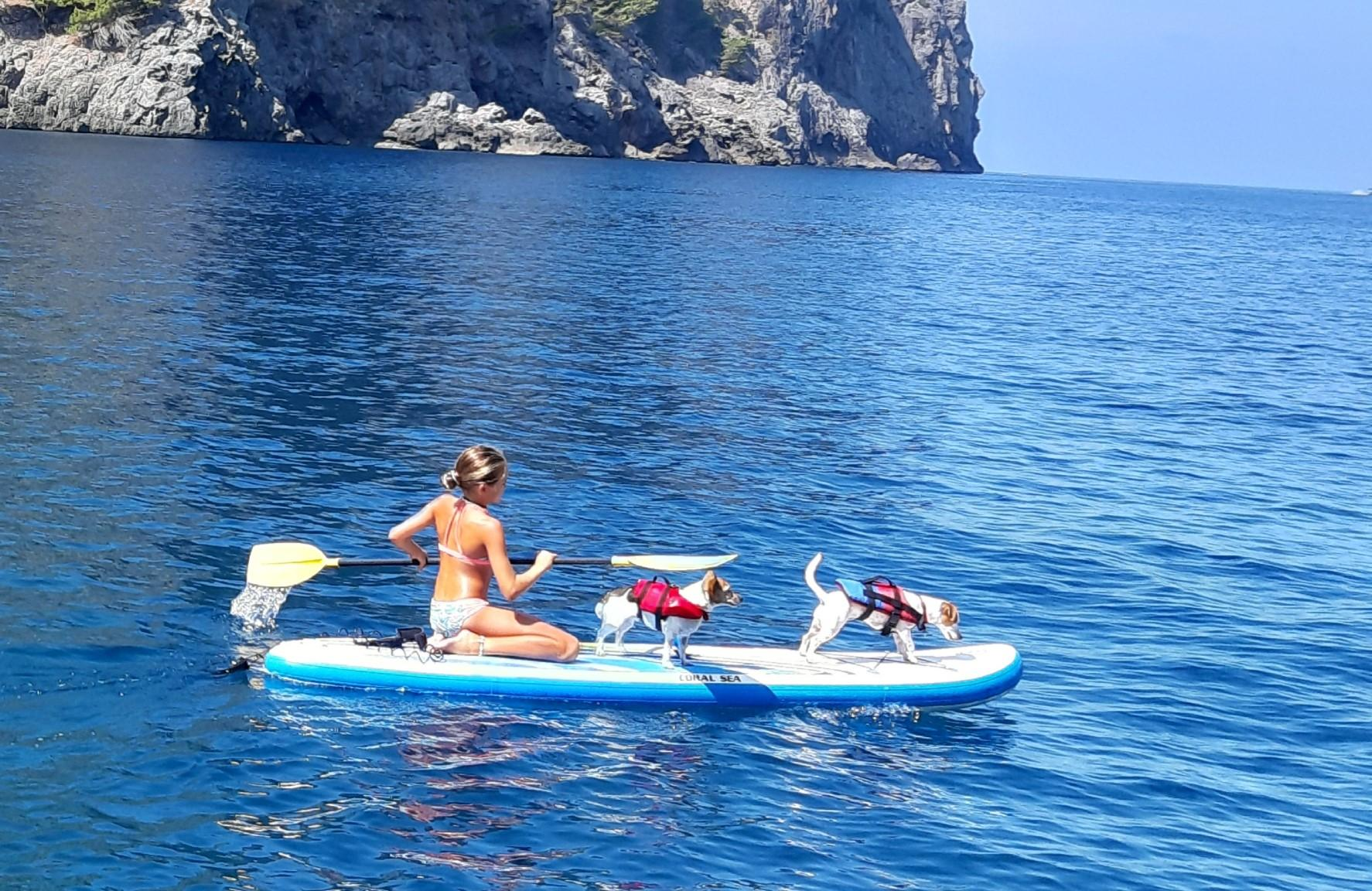 Naomi, Lucy and Dushi go paddleboarding.