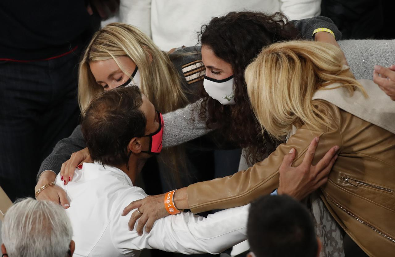 Rafa with sister, María and Mother.