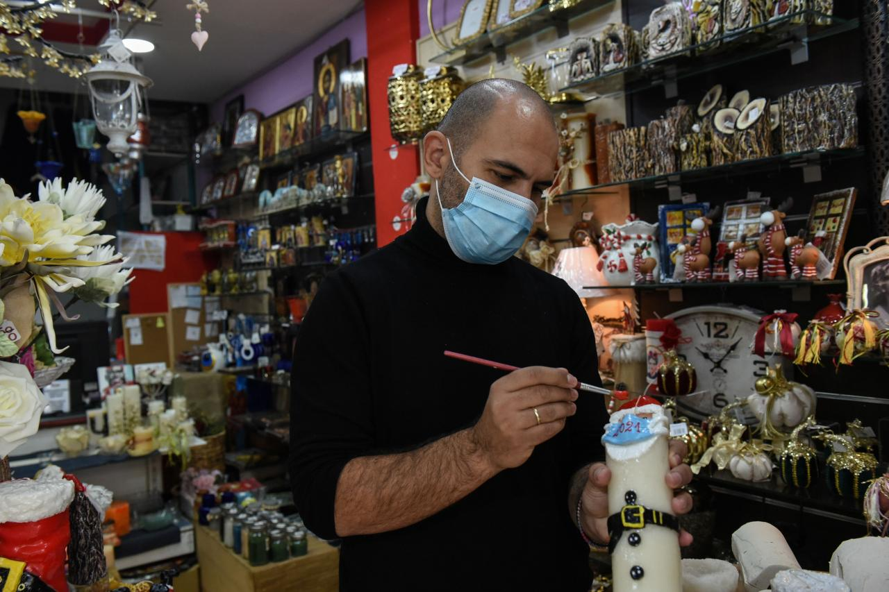 Candlemaker Gerakis puts the final touches on Christmas candle in Thessaloniki