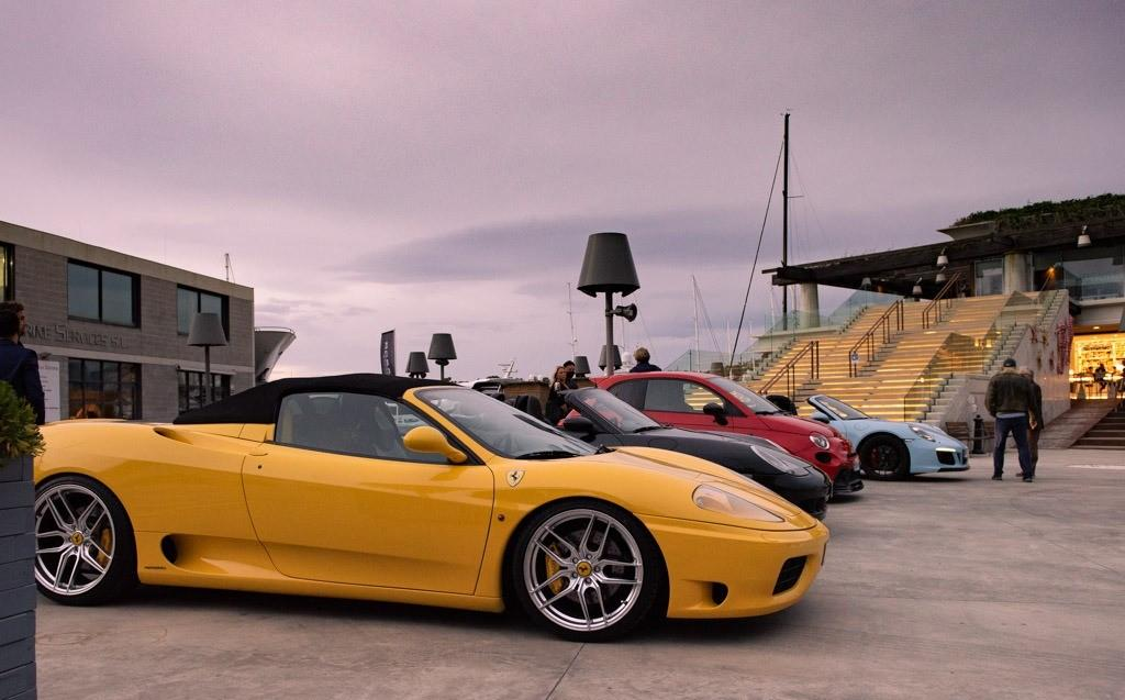Yellow Ferrari and pink sky composition
