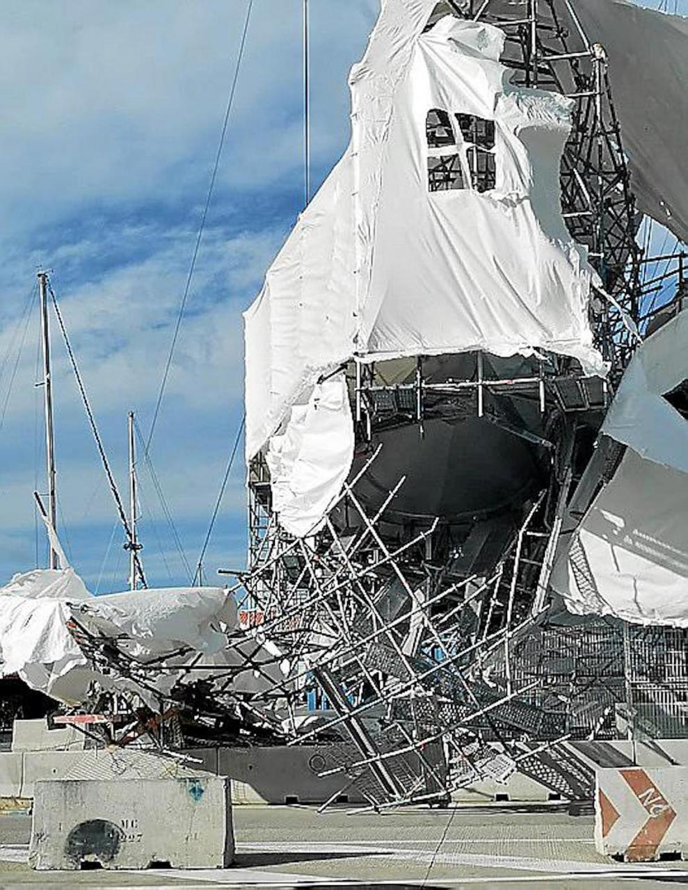 Huge tarpaulin torn of building in Carrer de la Dragonera in Palma.