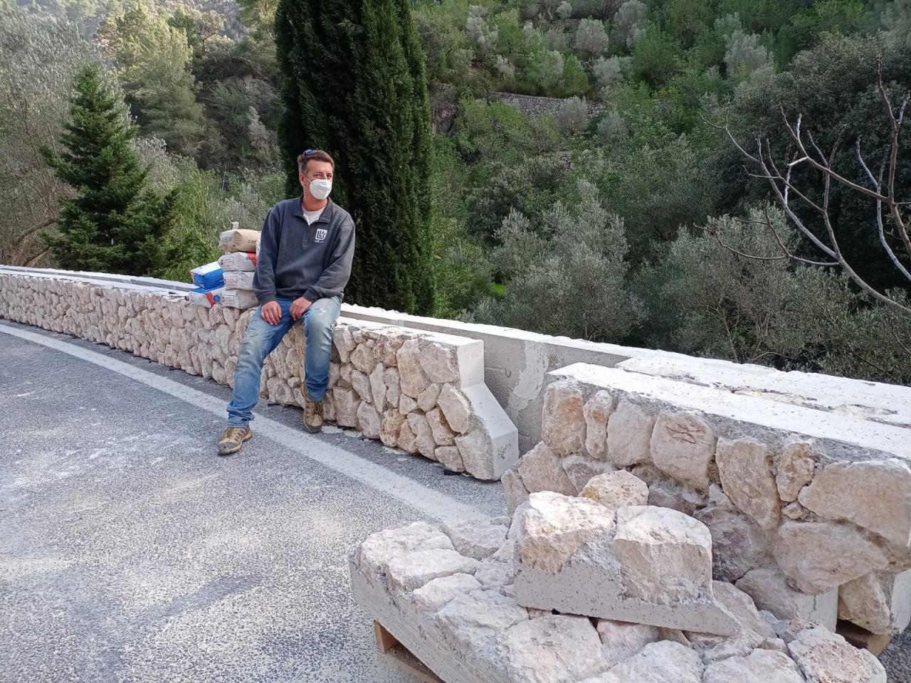 Lluc Mir, spokesperson for The Gremi de Margers on the prefabricated wall