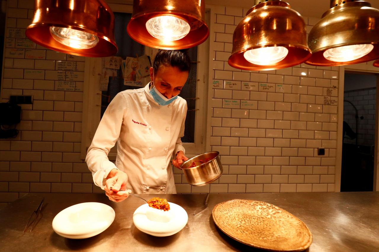 """Fraire, chef and owner of restaurant """"Etimo"""", prepares a dish in the kitchen of her restaurant in Madrid"""
