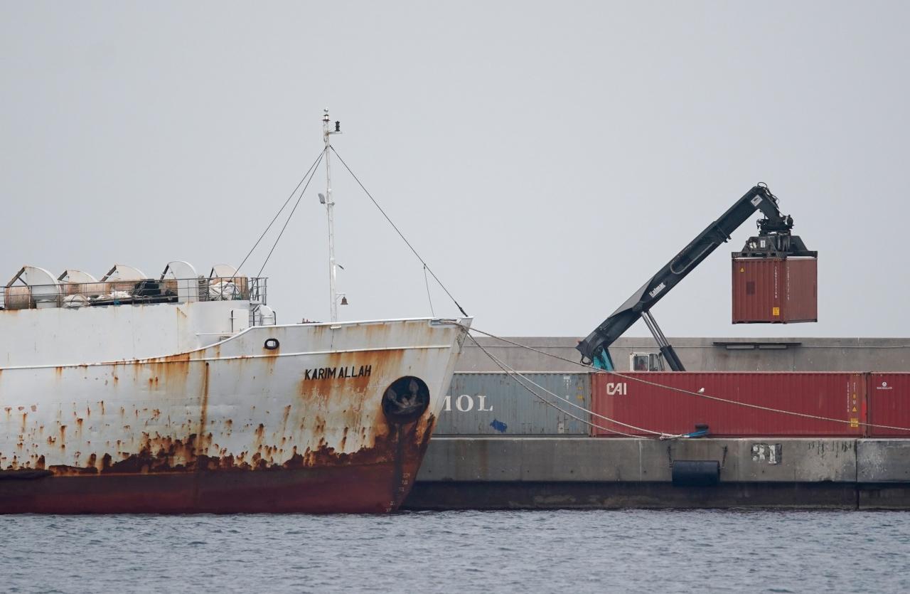"""A crane moves a container next to livestock ship """"Karim Allah"""""""