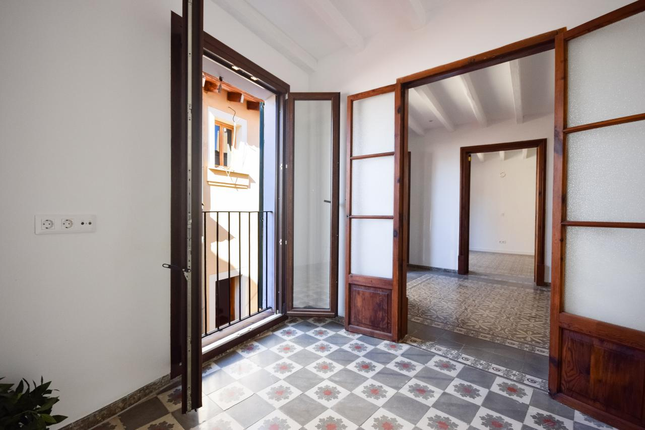 The apartment has a timeless typical Mallorcan floor throughout