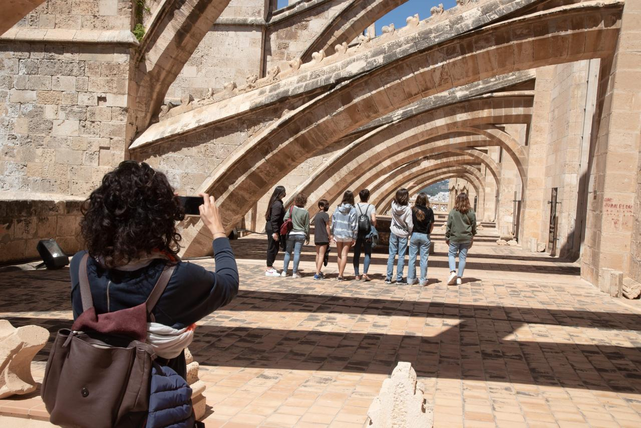 A group of tourists at Palma Cathedral.