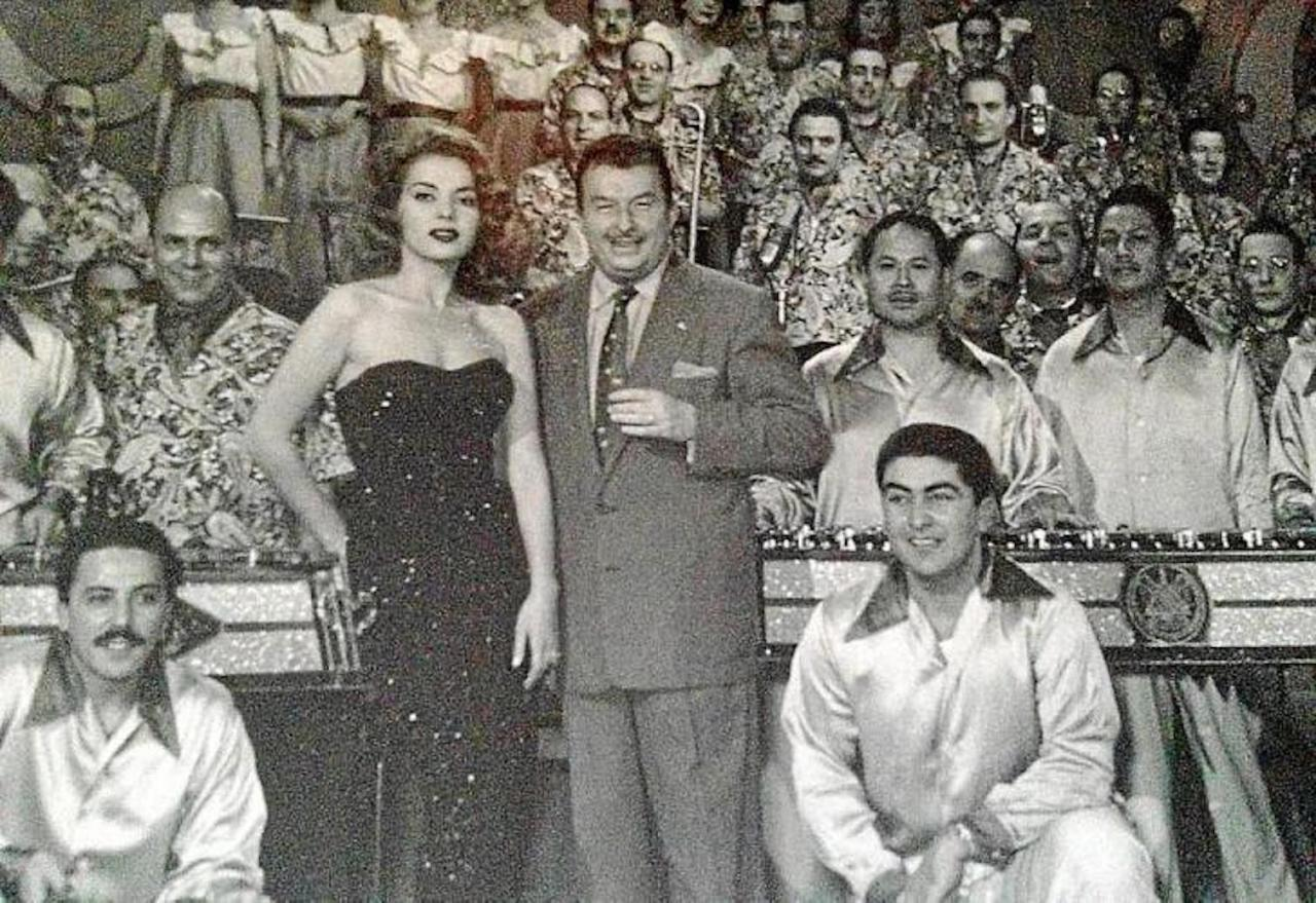 Catalan musician Xavier Cugat with his wife Abbe Lane & Andrés Cañas behind on the right.