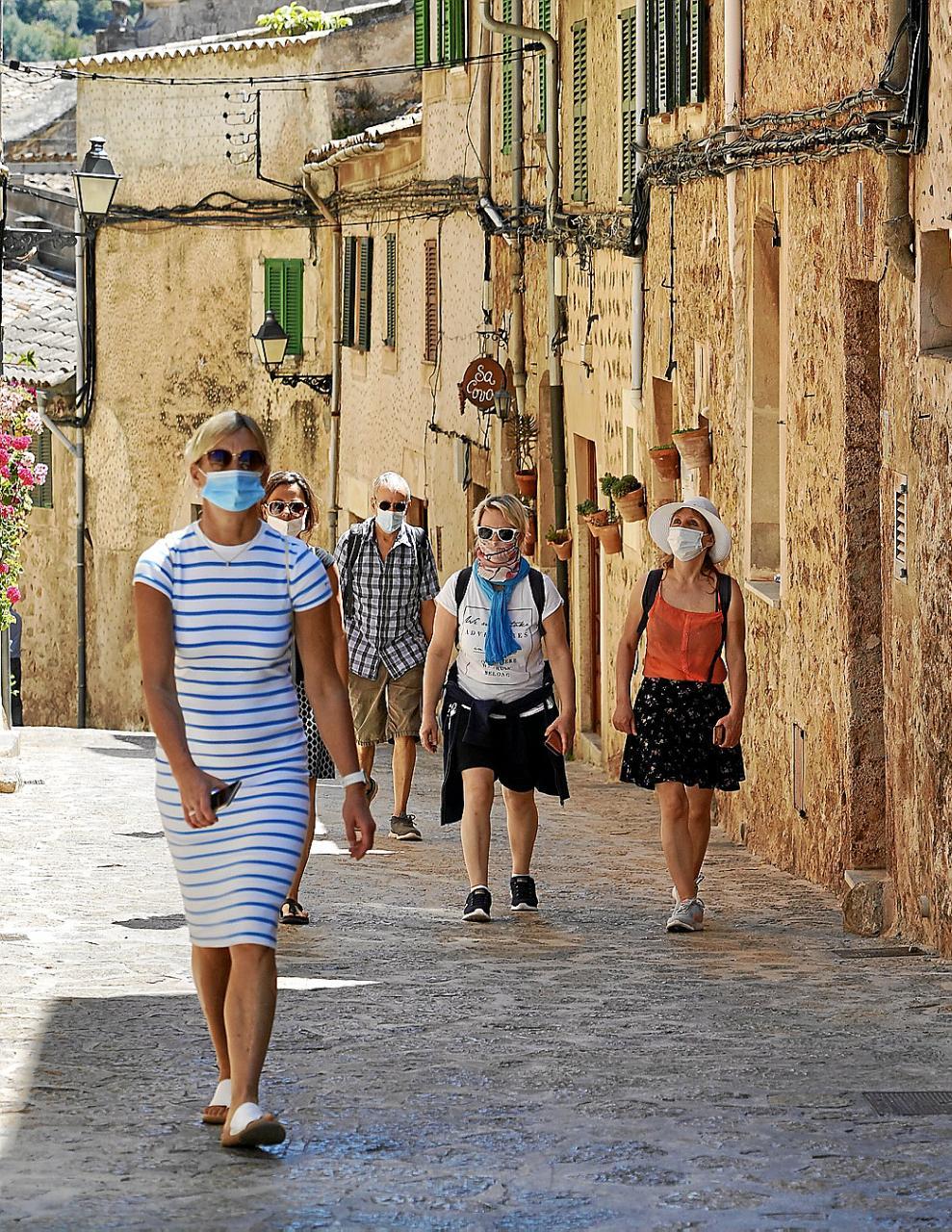 Tourists walking around in a village