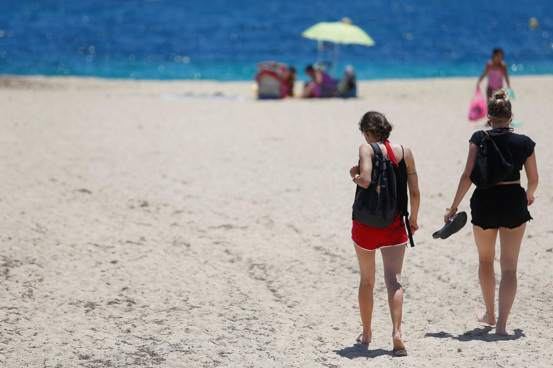 Tourists enjoy the weather at Magaluf beach