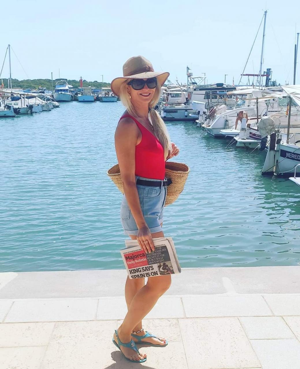"""Me, with a copy of Majorca Daily Bulletin before heading to """"Es Carbó Beach"""" by boat"""