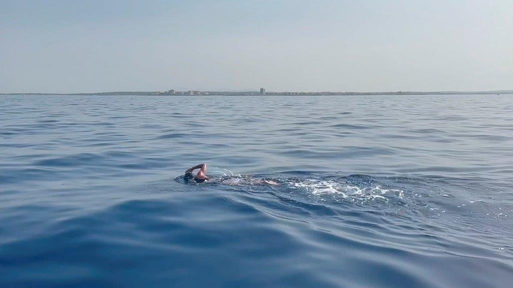 Caroline pictured swimming the final few kilometres to dry land in Majorca on Sunday, nearly six hours after having set off from Cabrera.