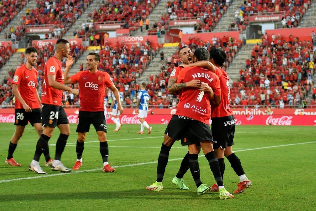 Mboula and Take Kubo celebrate Dani Rodriguez's goal.