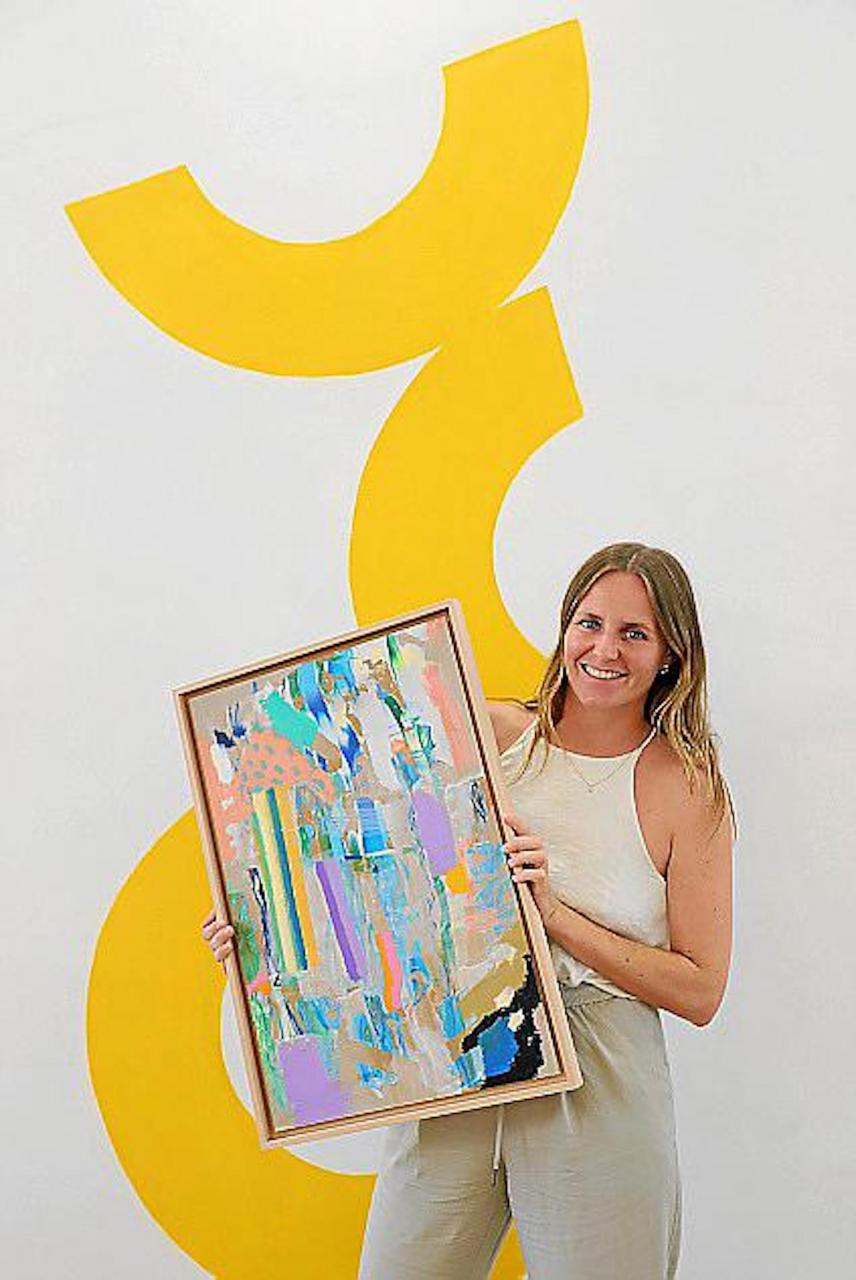 Tamara Neilsen with one of her paintings.