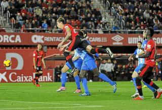 Raillo goes for goal during the home game against Malaga.