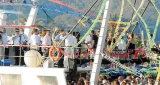Flotillas with the image of the Virgin Mary for the Virgen del Carmen fiestas.
