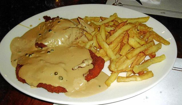 The chicken escalope with the flaccid french fries.