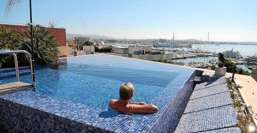 Rooftop pool at Can Barbarà overlooking the Paseo Maritimo.