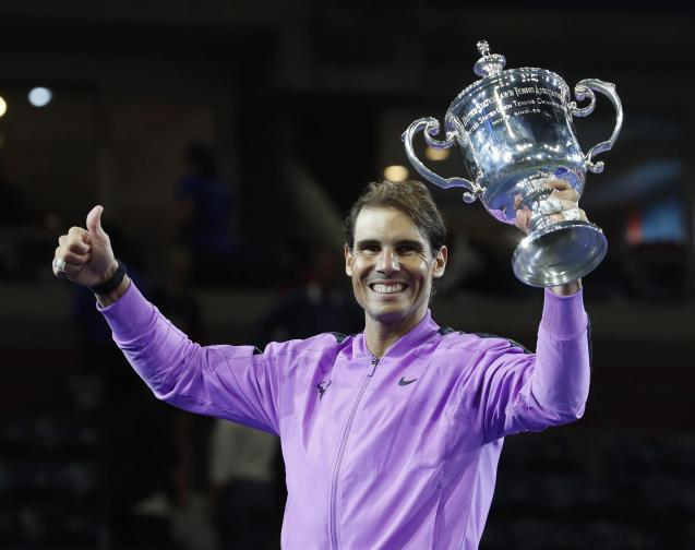 Rafael Nadal of Spain celebrates with the championship trophy after defeating Daniil Medvedev