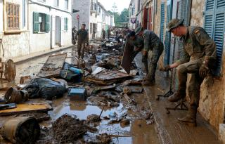 Rescue workers clear debris after heavy rain and flash floods hit Sant Lloreñç October 11, 2018.