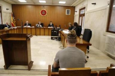 The accused awaiting sentencing.