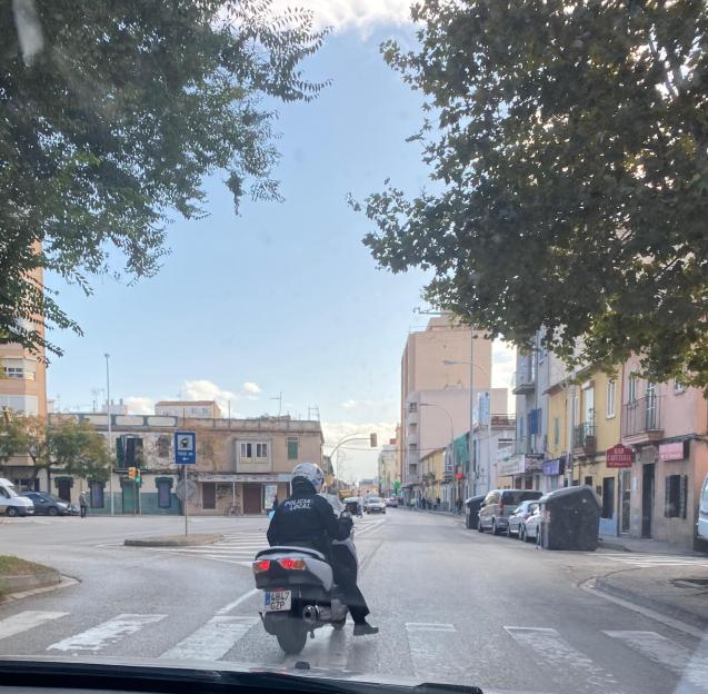 A policeman on an unmarked motorbike