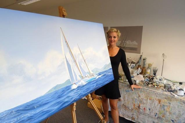 Artist Anna Boulton with one of her many captivating oil paintings