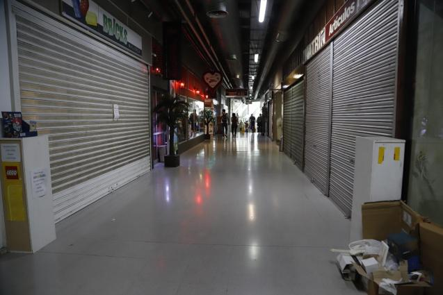 Many of the shops beneath Plaça Major are closed and for rent