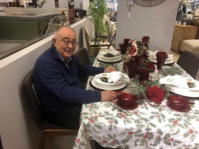 Tomeu Catalá sitting at a table at El Corte Inglés.
