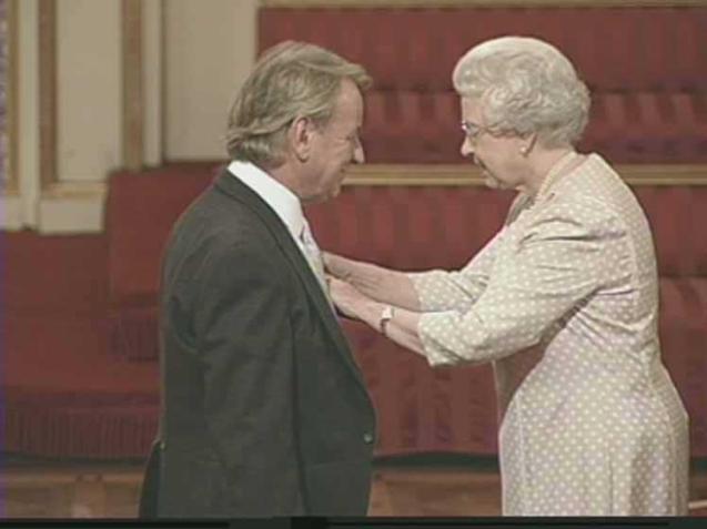 Robert Winsor recieving his MBE from Queen Elizabeth II