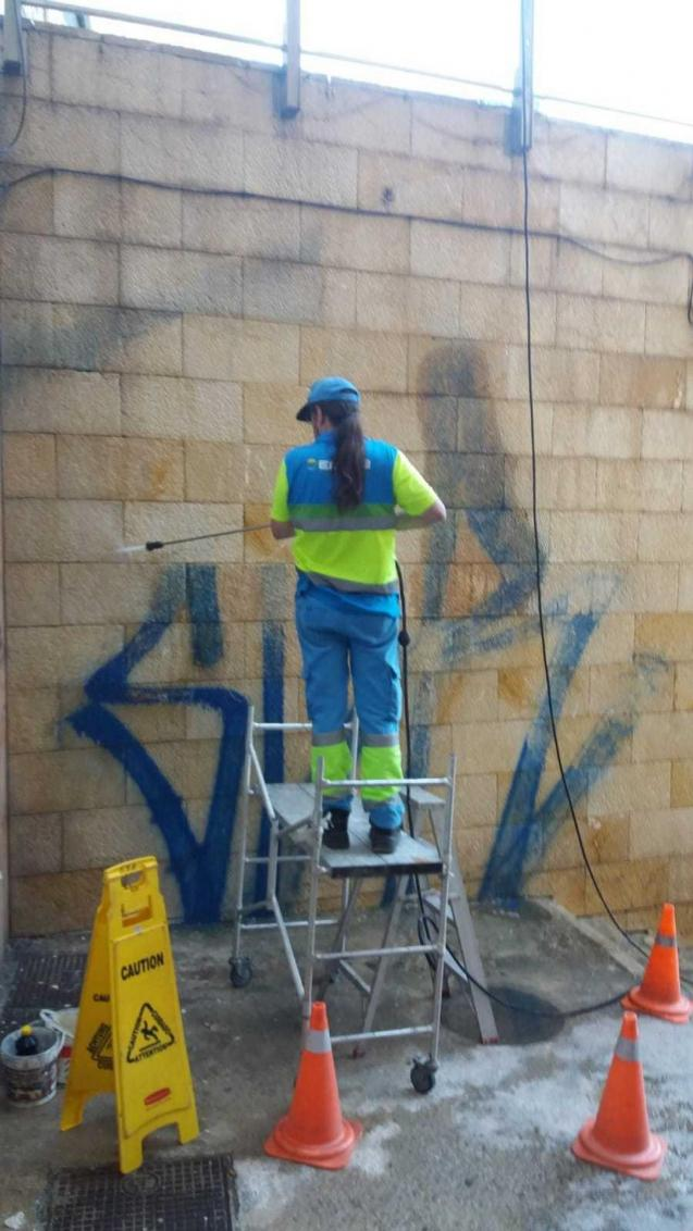 Graffiti removal by an Emaya employee
