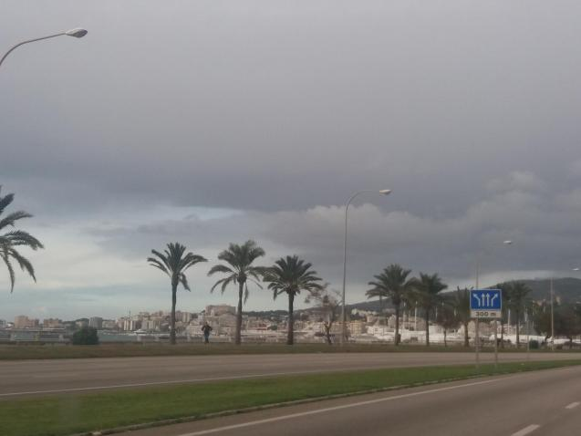 Overcast and breezy, small chance of rain