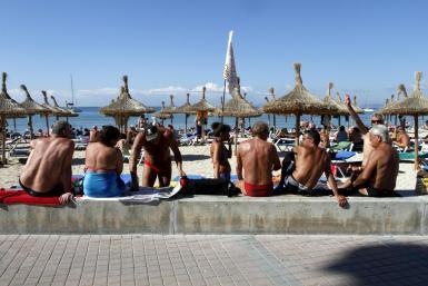 Tourists on the beach.