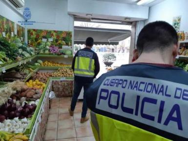 The police at the fruit shop.