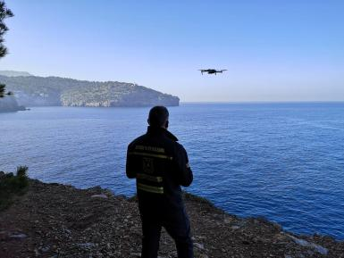 A drone is searching for the missing man in the sea.