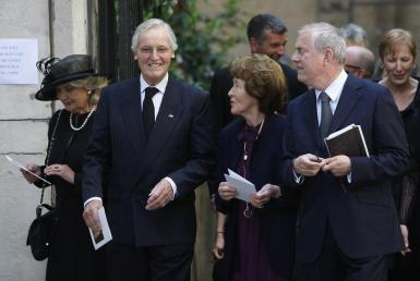 British entertainers Nicholas Parsons (2nd L) and Gyles Brandreth (R) leave the funeral of Clement Freud at St Bride's church in London April 24, 2009. Freud was the grandson of Sigmund Freud, and his funeral took place on Friday, which would have been his 85th birthday.