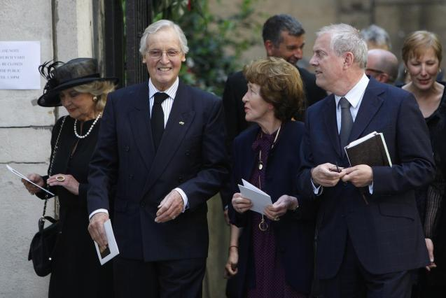 British entertainers Nicholas Parsons (2nd L) and Gyles Brandreth (R) leave the funeral of Clement Freud
