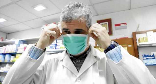 Toni Soler from Soler Feliu pharmacy trying on one of the coveted face masks