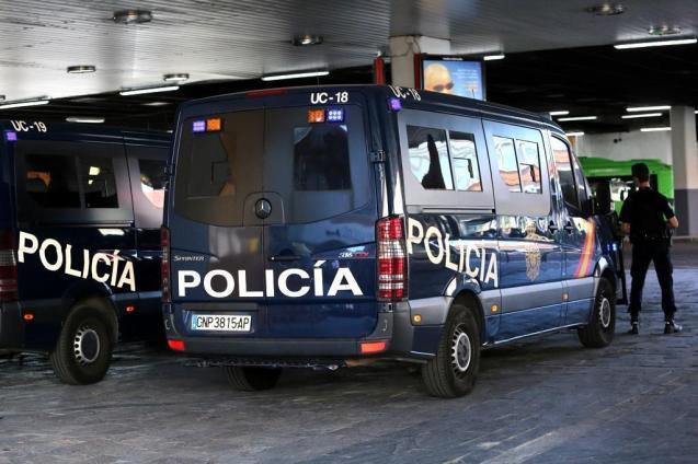 National Police Officers arrest three men