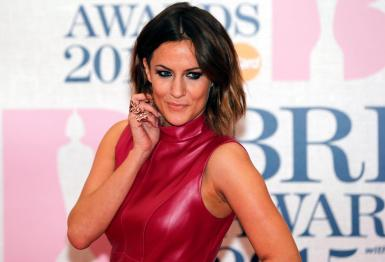 Television presenter Caroline Flack arrives for the BRIT music awards at the O2 Arena in Greenwich, London, February 25, 2015.