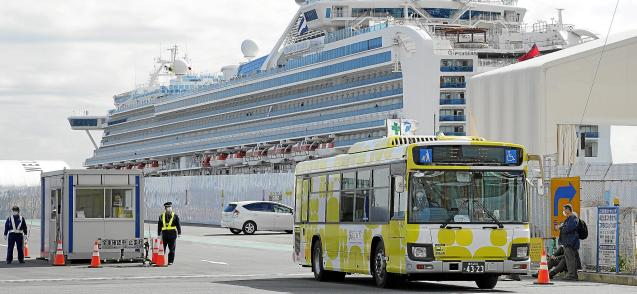 First passengers of quarantined cruise ship disembark, in Japan